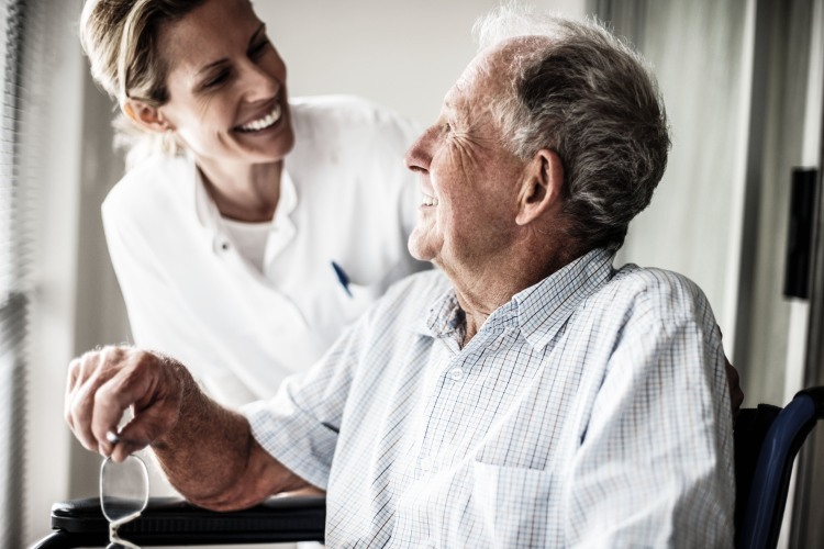 Nurse with smiling elderly man